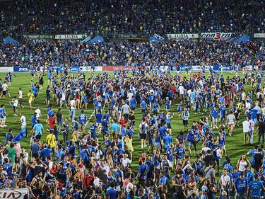 Invasión de campo en el Coliseum Alfonso Pérez tras el ascenso. (Foto: Getty)