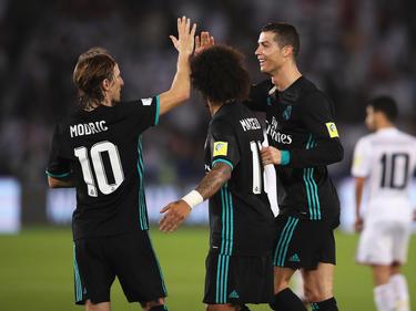 Modric, Marcelo y CR celebran el tanto del luso ante el Al Jazira. (Foto: Getty)