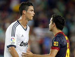 Im Trikot von Barcelona und Madrid standen sich Xavi (r.) und Ronaldo (l.) häufig gegenüber