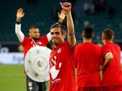 Philipp Lahm feierte den Meistertitel mit den Bayern-Fans. Foto: Swen Pförtner