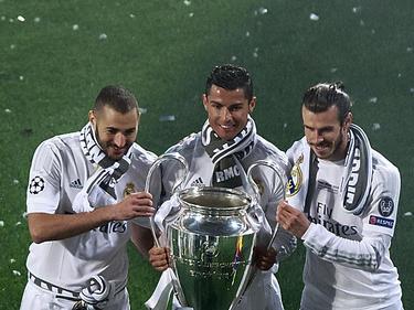 Benzema, Cristiano y BAle celebran la Undécima. (Foto: Getty)