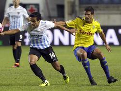 Garrido (dcha.) en un amistoso contra el Málaga CF. (Foto: Imago)