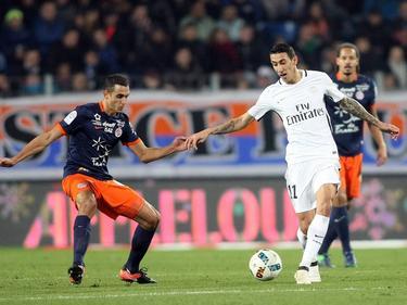 Ryad Boudebouz defiende un ataque de Ángel Di María. (Foto: Imago)