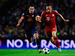 Xavi und Riéry kennen sich noch aus der Champions League