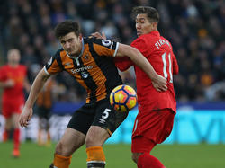 Harry Maguire (l.)