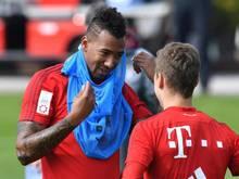 Jérôme Boateng (l.) will den Bayern schnell wieder helfen