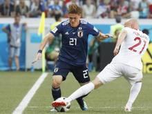 Gotoku Sakai (l.) wird nicht mehr für Japan spielen