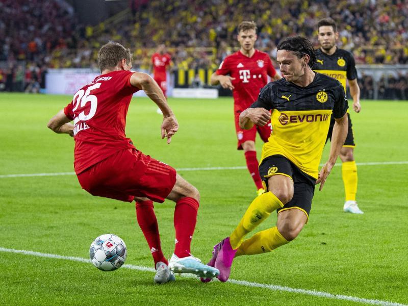 Nico Schulz (r.) trifft mit seinen Dortmundern auf den FCB