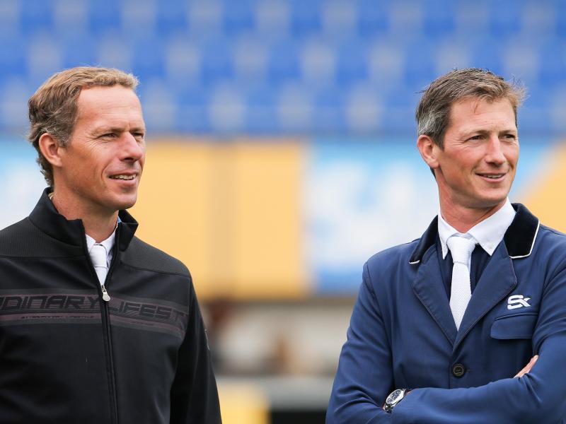Die Reiter Christian Ahlmann (l) und Daniel Deußer haben die formalen Kriterien für einen Olympia-Start erfüllt