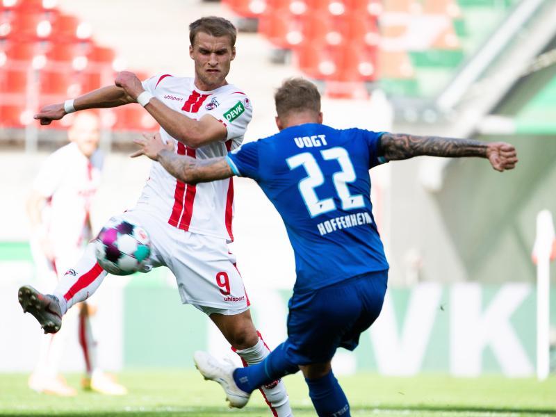 Kölns Sebastian Andersson (l) hatte sich im Training verletzt