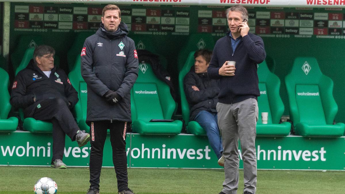 Frank Baumann (re.) und Werder setzen weiter auf Florian Kohfeldt