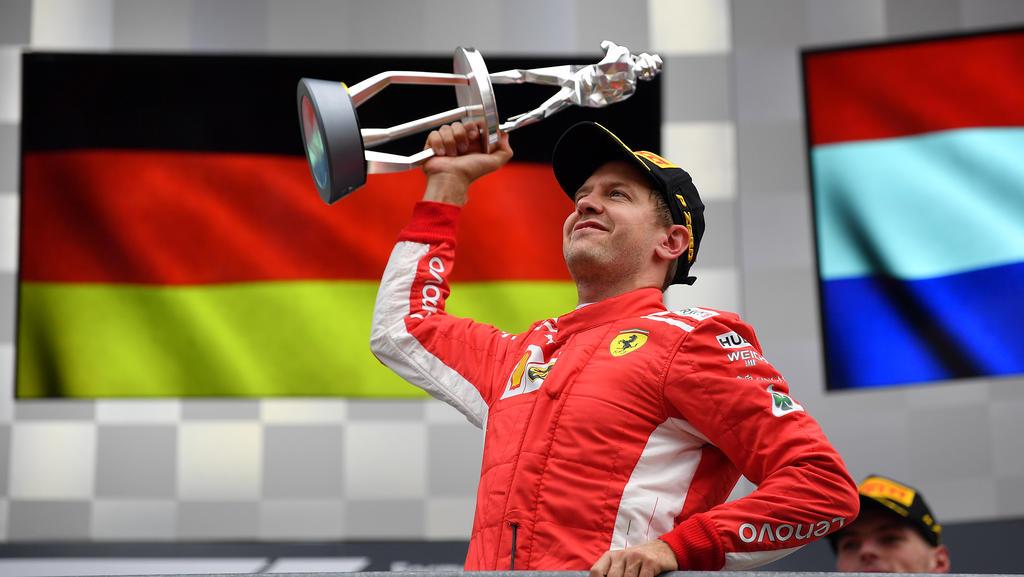 Der König von Spa mit seiner Königin: Sebastian Vettel mit Loria
