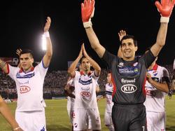 Die Spieler von Club Nacional freuen sich nach dem späten Ausgleich