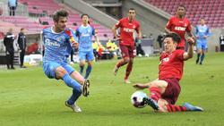 Fin Bartels (l.) trifft mit Holstein Kiel auf den 1. FC Köln