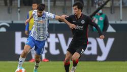 Daichi Kamada (r.) kam gegen Hertha BSC nur als Einwechselspieler