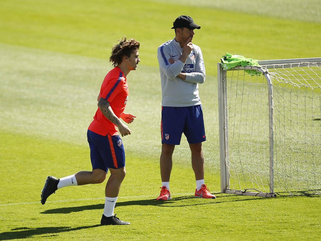 Simeone y Griezmann en un entrenamiento.