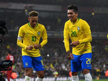 Neymar y Firmino formarán la dupla de ataque en Brasil.