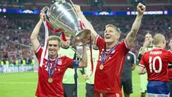 Philipp Lahm (l.) gewann 2013 mit dem FC Bayern die Champions League