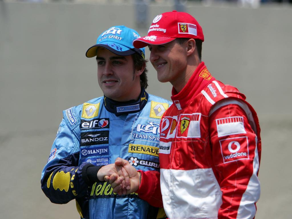 Fernando Alonso (li.) und Michael Schumacher