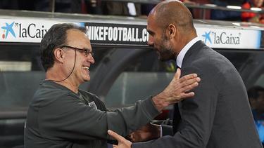 Guardiola (re.) freut sich auf seinen argentinischen Kollegen