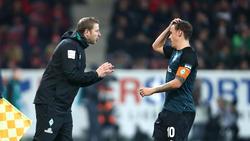 Werder-Coach Florian Kohfeldt setzt auf Max Kruse (re.)