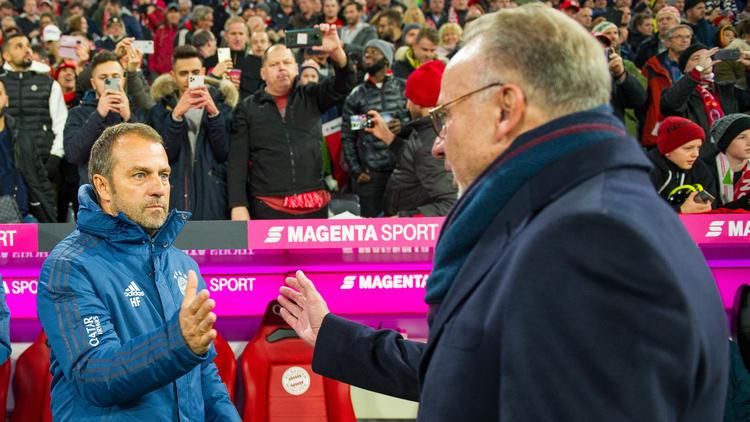 Hansi Flick (l.) hat einen Vertrag bis zum Sommer 2020 beim FC Bayern
