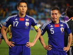 Makoto Hasebe (izq.) y Yuto Nagatomo