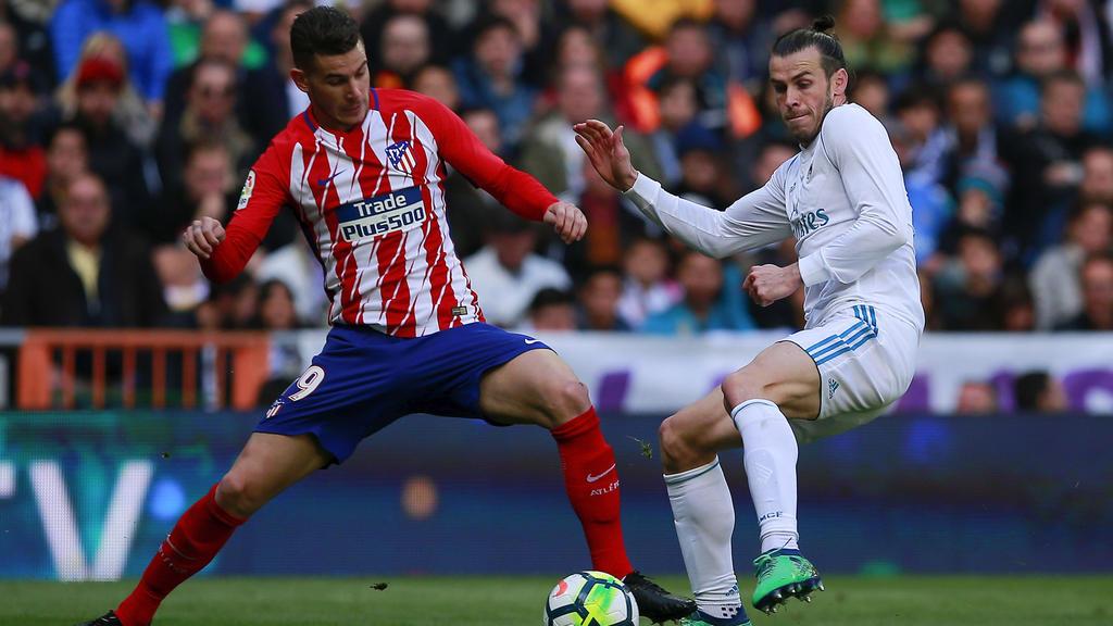 Lucas Hernández (l.) im Duell mit Gareth Bale