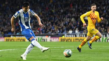 Wu Lei anotó el empate de tiro cruzado.