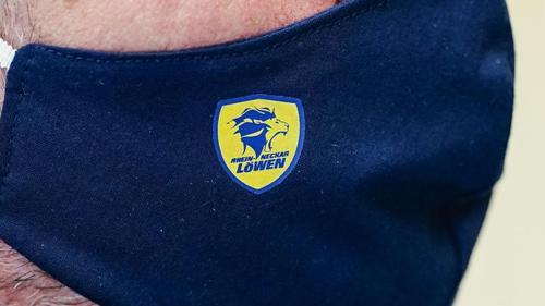 Das Logo der Rhein-Neckar Löwen auf einem Mund-Nasen-Schutz