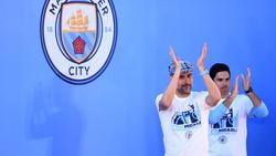 Guardiola y Arteta celebrando un título del City.