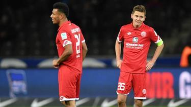 Die Mainzer Karim Onisiwo (l.) und Niko Bungert haben sich am 3. Spieltag verletzt
