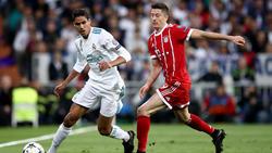 Spielen Raphael Varane (l.) und Robert Lewandowski bald zusammen beim FC Bayern?