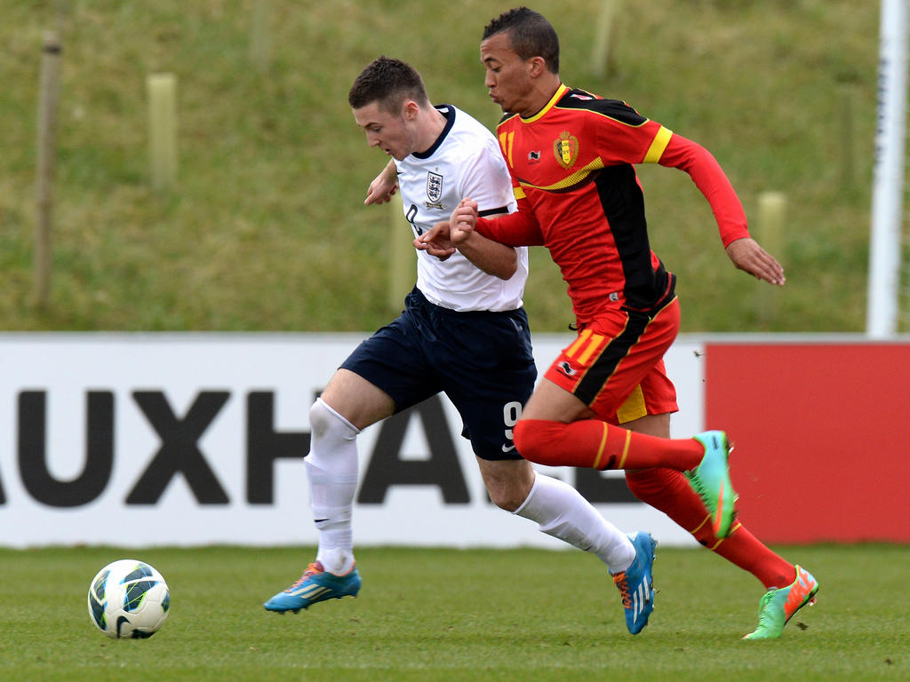 David Henen is challenged by Bradley Fewster