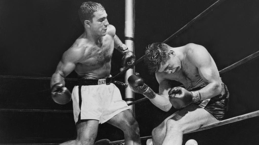 Rocky Marciano (li.) beendete seine Karriere mit einer Bilanz von 49 Siegen in 49 Kämpfen