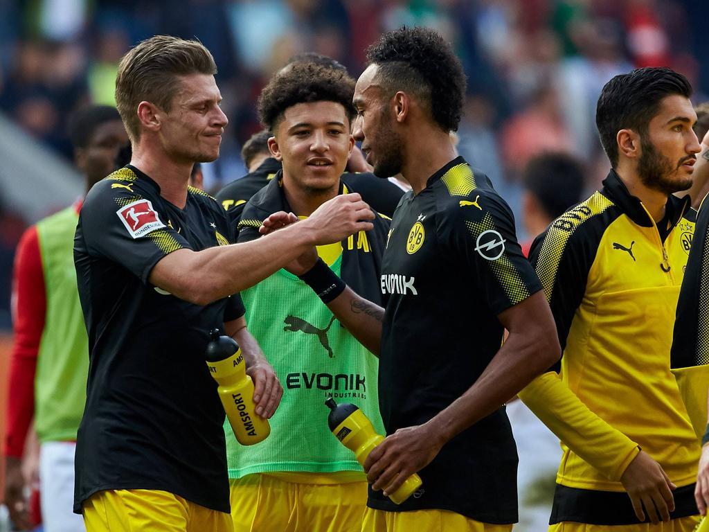 Borussia Dortmund feiert Zittersieg in Augsburg