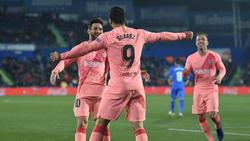 Messi y Suárez marcaron en Gentfe y lideran la tabla de goleadores. (Foto: Getty)