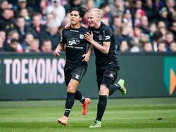NEC komt al snel na de openingstreffer van Ajax naast de Amsterdammers. Navarone Foor (l.) scoort, Lucas Woudenberg viert mee. (13-03-2016)