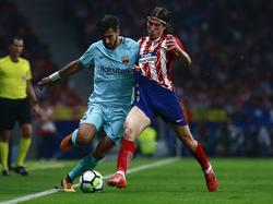 Filipe Luis tuvo mucho trabajo por su flanco ante el Barça. (Foto: Getty)