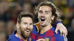 Ließen sich in Madrid von den Schmähungen nicht den Torjubel verderben: Barcelonas Torschütze Lionel Messi (l.) mit Antoine Griezmann