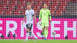"""Der Ausfall von Kimmich (l.) """"tut weh"""", sagt DFB-Kapitän Neuer (r.)"""