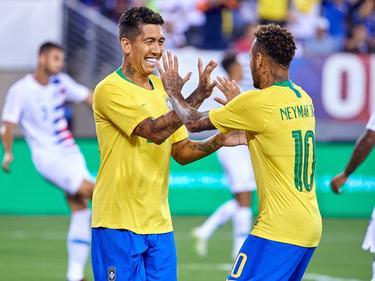 Firmino y Neymar celebran su victoria contra Estados Unidos. (Foto: Imago)