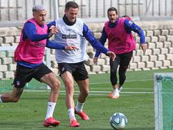 Giménez, Saúl y Koke en una sesión del Atlético.