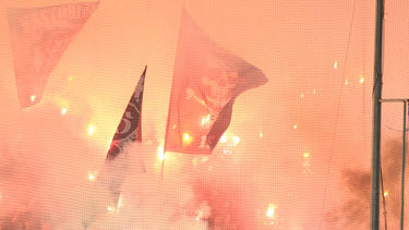 PAOK fans light flares during a soccer match between PAOK and Olympiacos.