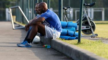 Nicolas Anelka and his teammates of Shanghai Shenhua FC look on during a training session at Shanghai Shenhua Football Training Centre in Shanghai, China, 16 October 2012.