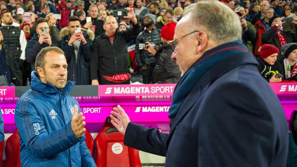 Hansi Flick (l.) hat beim FC Bayern verlängert