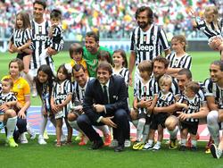 Antonio Conte e alcuni calciatori della Juve