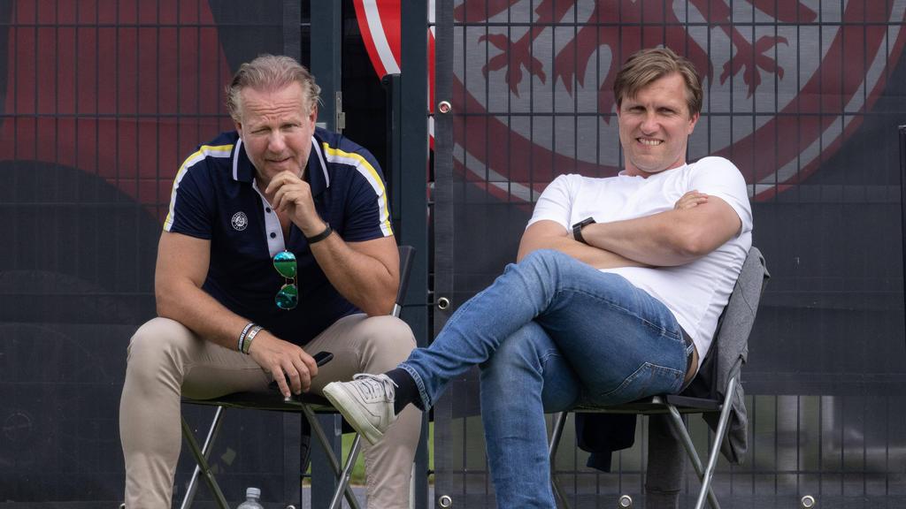 Eintracht Frankfurts Boss Philip Holzer (l.) befürchtet Verluste