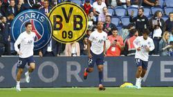 Julian Draxler (l.), Abdou Diallo (M.) und Juan Bernat (r.) bereiten sich auf das Spiel gegen den BVB vor