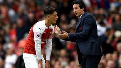 Verlässt Mesut Özil (l.) den FC Arsenal?